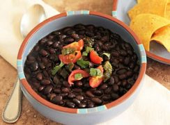 Pressure Cooker (Instant Pot) Black Beans in a white and orange bowl