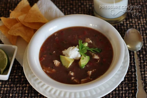 a white bowl filled with Pressure Cooker (Instant Pot) Picante Chicken and Black Bean Soup