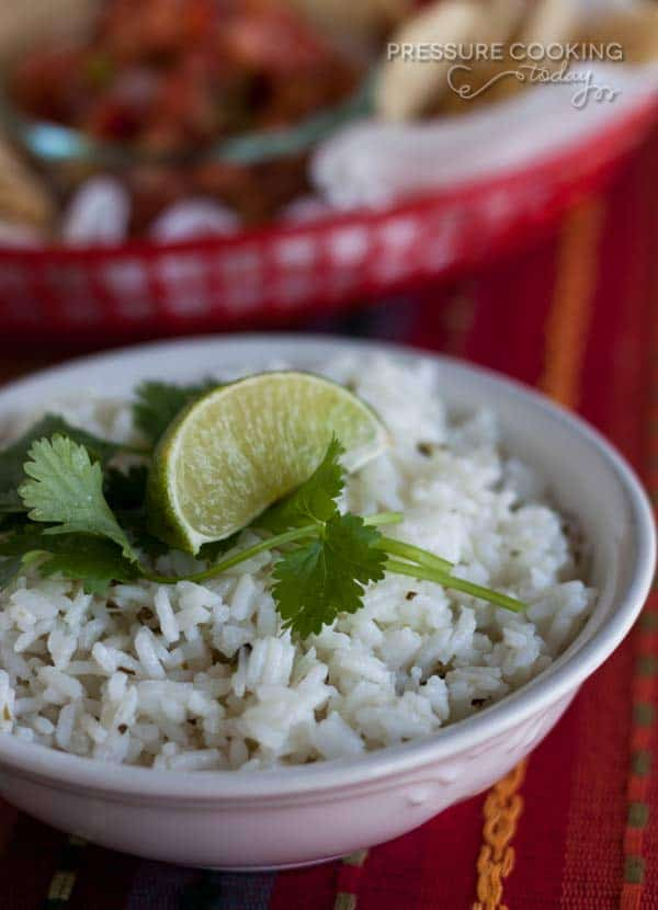 This Pressure Cooker Chipotle\'s Cilantro Lime Rice is perfect as a side dish with your favorite Mexican meal, or as the base of a burrito bowl the way they serve it at Chipolte\'s.