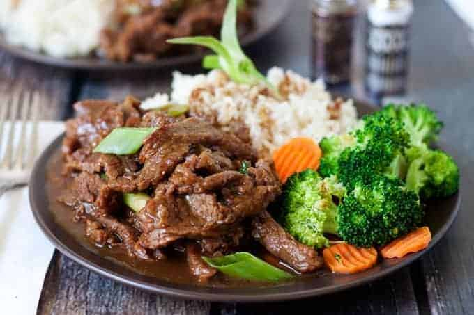 Pressure Cooker (Instant Pot) Mongolian Beef Recipe served on a plate with broccoli and carrots and rice