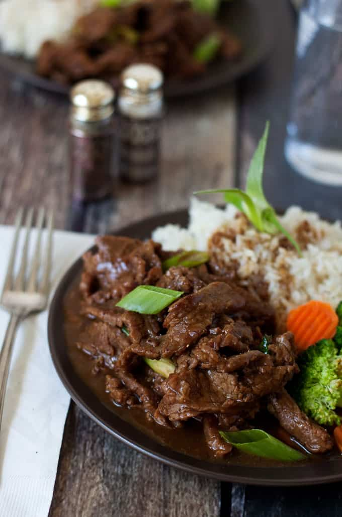 Pressure Cooker Mongolian Beef made with flank steak thinly sliced then cooked in a sweet, garlic and ginger sauce until it\'s melt in your mouth tender.