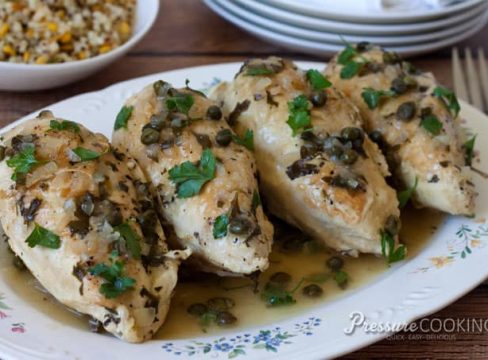 Pressure Cooker (Instant Pot) Braised Chicken with Capers and Parsley on a white serving platter