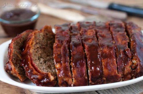 Pressure Cooker (Instant Pot) BBQ Bacon Meatloaf sliced on a serving platter and ready to serve.