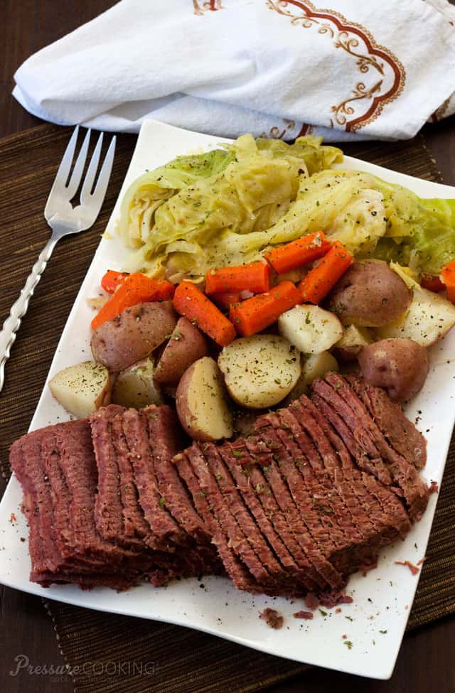 Pressure Cooker Corned Beef and Cabbage served on a white plate and ready to eat