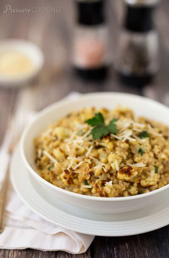 Pressure Cooker Roasted Cauliflower Barley Risotto with Parmesan Cheese in a white bowl