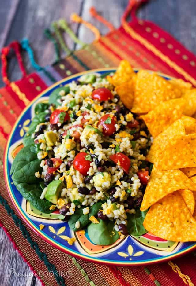 This Spicy Brown Rice Black Bean Salad is full of flavor with lots of great textures. The spicy lime dressing brightens up the salad and give it it\'s spicy kick.