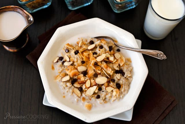 Pressure Cooker (Instant Pot) Almond Joy Steel Cut Oats in a white bowl with a spoon