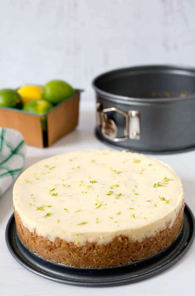 "A tart, creamy key lime pie with a graham cracker crust ""baked\"" in the pressure cooker, then served topped with some lightly sweetened whipped cream."
