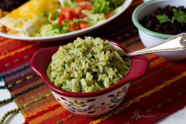 This Pressure Cooker (Instant Pot) Mexican Green Rice made with avocado, cilantro, and green salsa is a fabulous alternative to traditional Spanish rice.