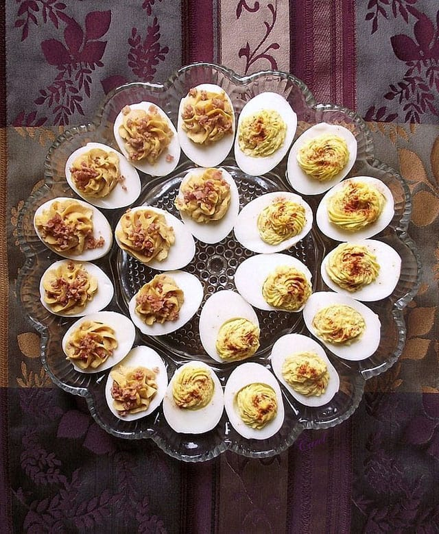 Deviled eggs on a glass egg platter