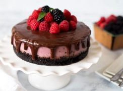 Pressure Cooker (Instant Pot) Raspberry Cheesecake on a cake stand