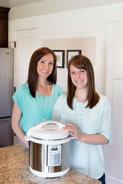 Picture of two women standing behind an Instant Pot