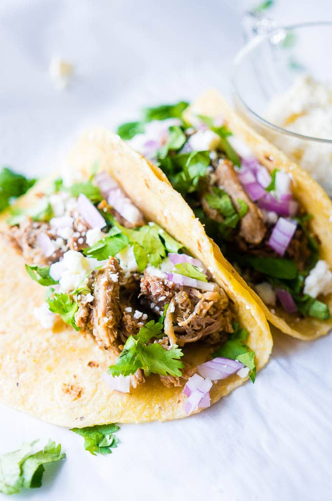 Pressure Cooker Green Chile Pork Carnitas. Moist, flavor-packed, and fall apart in your mouth tender, these green chili pork carnitas tacos are the perfect solution for a speedy family friendly dinner!