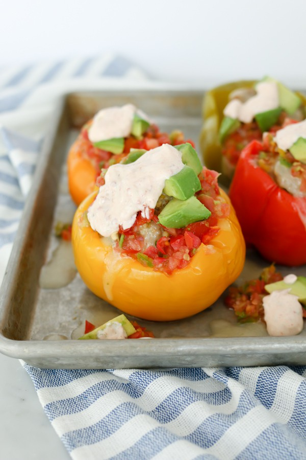 Pressure Cooker Mexican Stuffed Bell Peppers with Chipotle Lime Sauce on a sheet pan