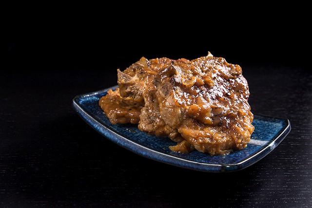 blue platter holding Maple Dijon Mustard Pork Chops made in a pressure cooker