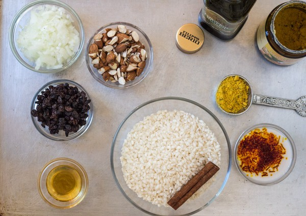 prep bowls with ingredients for Pressure Cooker Saffron Risotto with Almonds and Currants