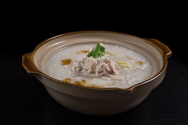 Pressure Cooker Chicken Porridge in a terra cotta soup bowl