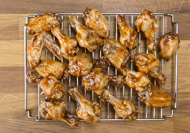 pressure cooked bbq wings on a metal cooling rack