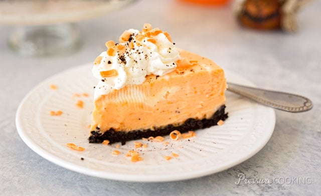 Pressure Cooker (Instant Pot) Orange Marble Cheesecake served on a white dessert plate