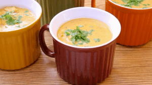pressure-cooker-mulligatawny-soup served in a red cup