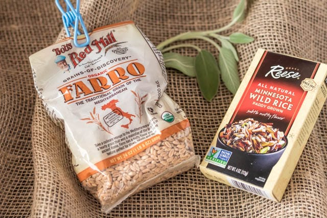 box of Wild Rice mix and bag of Bob's Red Mill Farro on a burlap cloth