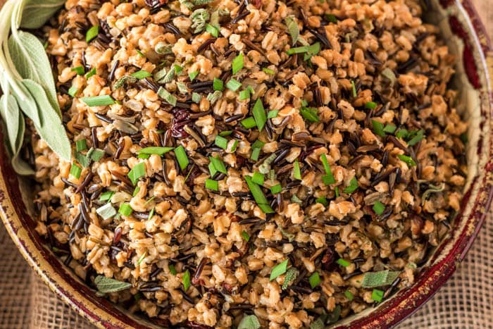 Pressure Cooker Wild Rice and Farro Pilaf with dried cherries, fresh herbs, and toasted hazelnuts. A healthy side on your table in less than 45 minutes!