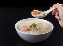 Pressure Cooker (Instant Pot) Turkey Rice Porridge in a white bowl with a spoonful of soup above it