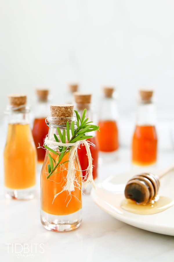 Glass bottles with flavor infused honey made in a pressure cooker