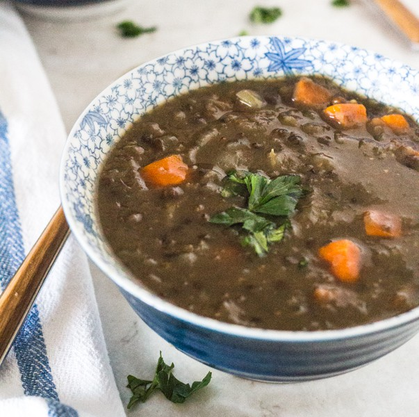 blue and white soup bowl with Pressure Cooker Hearty Lentil Beer Soup