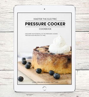 ipad with cookbook cover photo for Master the Electric Pressure Cooker Cookbook