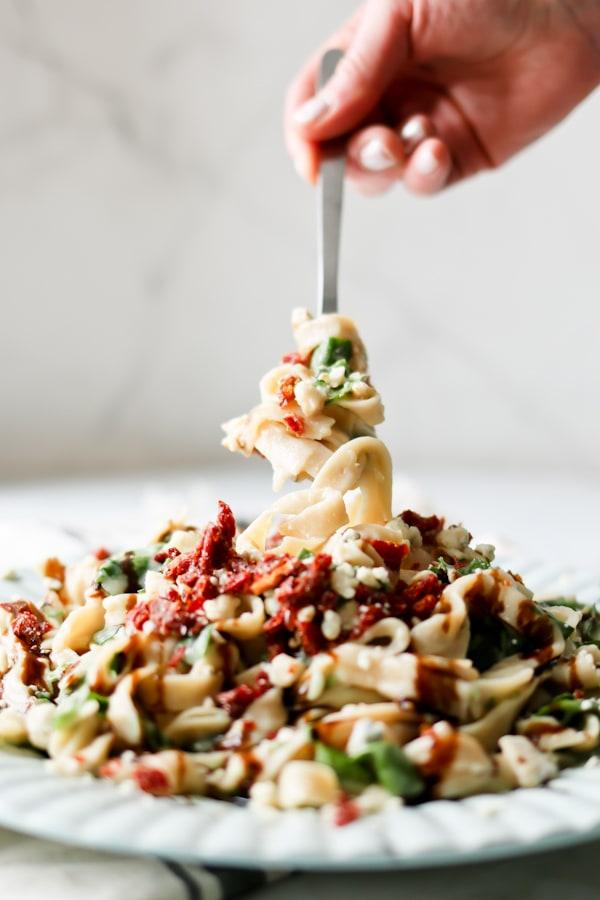 Pressure Cooker Cauliflower Fettuccine Alfredo twirled onto a dinner fork