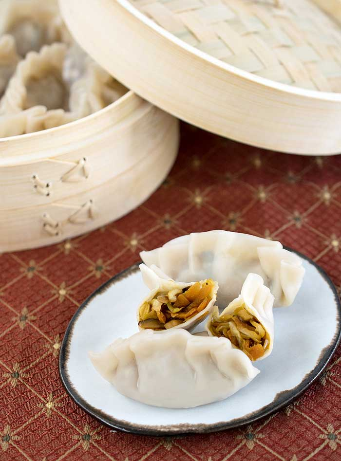 Pressure Cooker Asian Steamed Dumplings served on a white plate