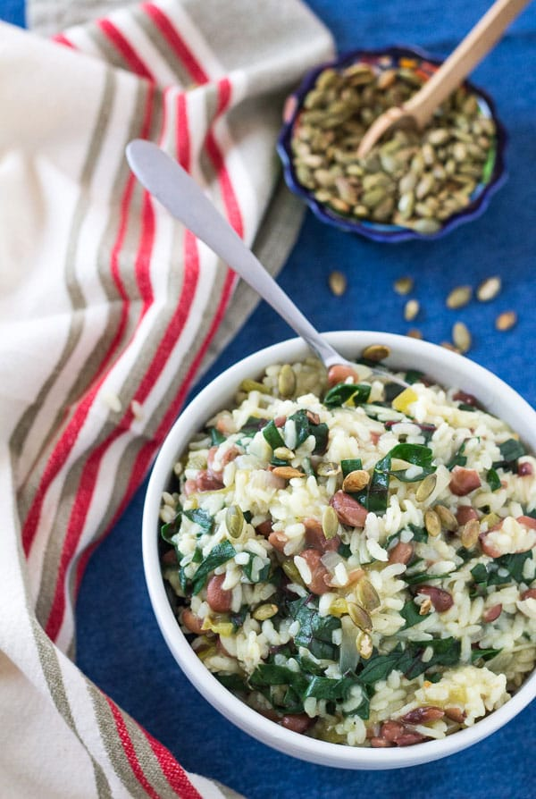 large white bowl filled with Southwest Pinto Bean and Chard Risotto