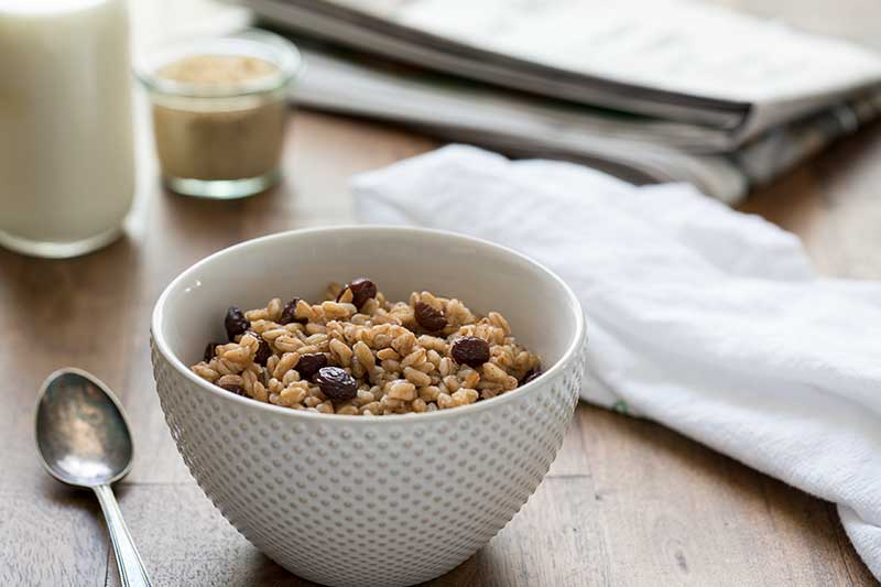 Pressure Cooker (Instant Pot) Brown Sugar Raisin Breakfast Farro served in a white bowl