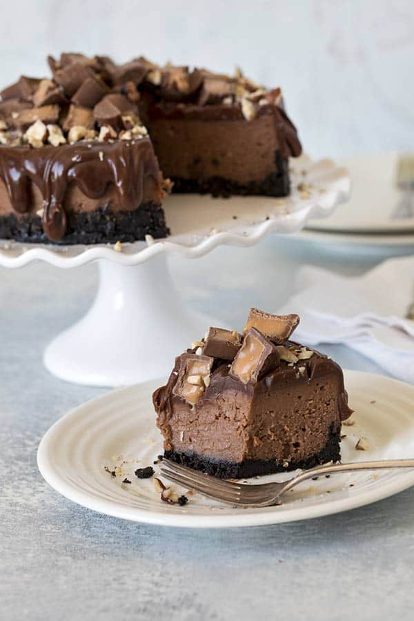 Pressure Cooker Nutella Rolo Cheesecake on a white plate with a fork