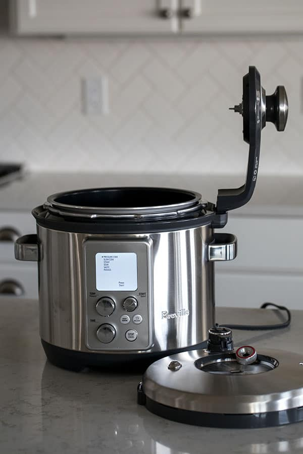 The arm on the Breville The Fast Slow Pro Pressure Cooker is not removable.