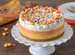 Pressure Cooker (Instant Pot) Candy Corn Cheesecake on a cake stand