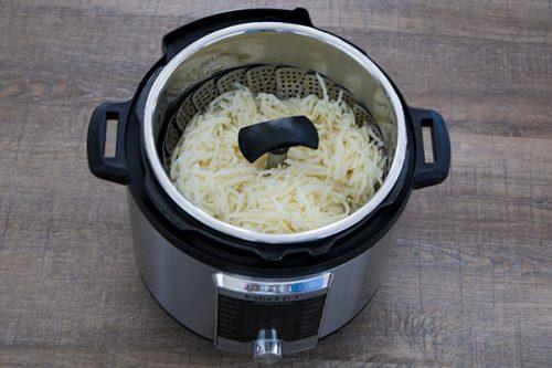 Steamer basket for making pressure cooker Hash Brown Potato Casserole.