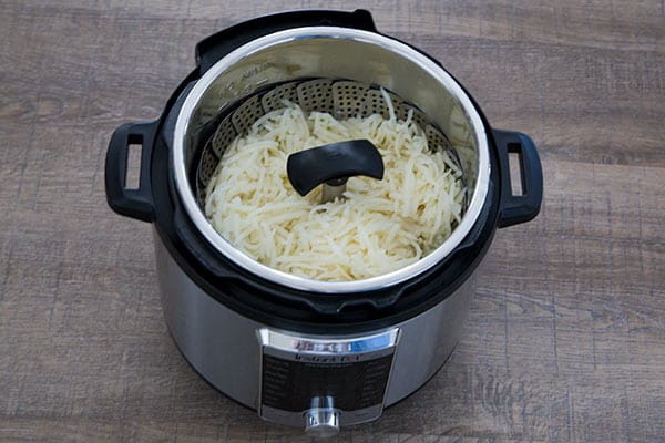 Pressure Cooker Cheesy Hash Brown Casserole using the OXO steamer basket.
