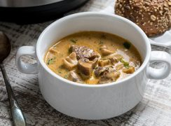 Pressure Cooker Beef and Mushroom Stew in a white bowl