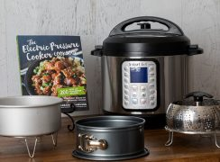 Electric Pressure Cooker Cookbook along with several of my favorite pressure cooking accessories (cake pan, trivet, springform, and steamer)