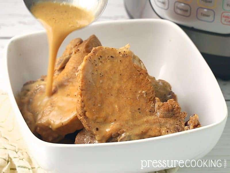 Easy Pressure Cooker Pork Chops in Mushroom Gravy - Try this old-fashioned recipe in your Instant Pot today!