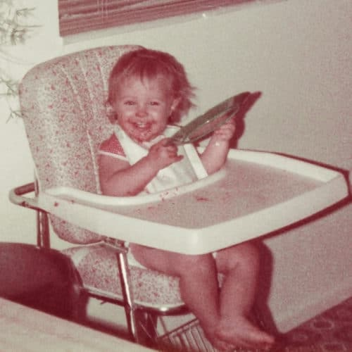 A small child sitting in a high chair