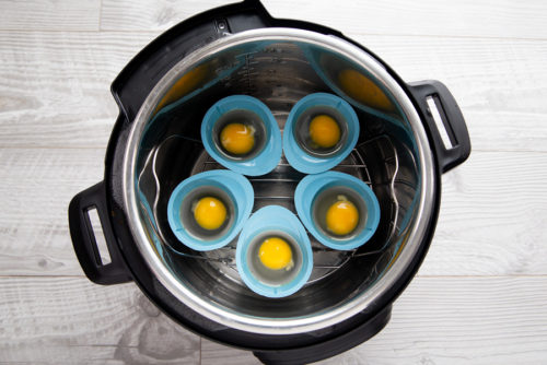 Five poached eggs going into the InstaPot to poach