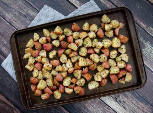 A sheet pan with Instant Pot garlic roasted red potatoes