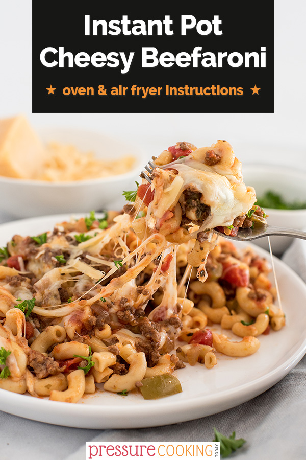 Pinterest image featuring a close up on a cheese pull from instant pot / pressure cooker american chop suey / beefaroni via @PressureCook2da