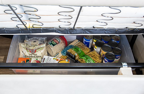 Pantry basics for cooking in an Insta Pot packed under the trailer couch