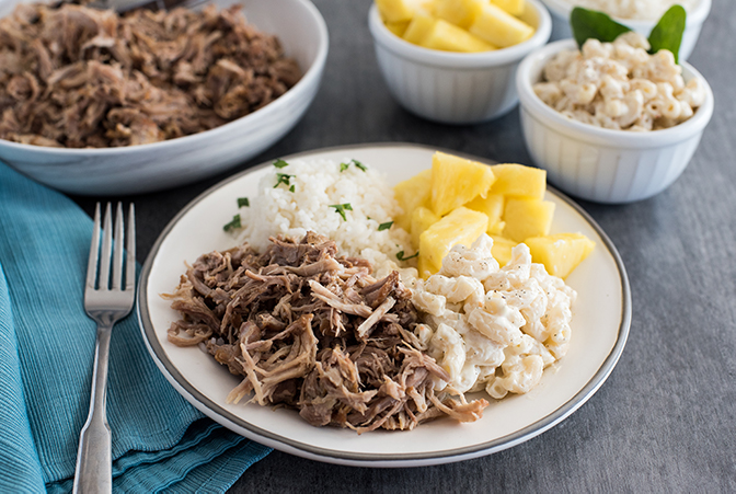 Insta Pot Kalua Pork recipe, plated and ready to serve with pineapple and macaroni and cheese