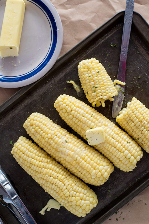 A pan full of corn on the cob, cooked and ready from the electric pressure cooker