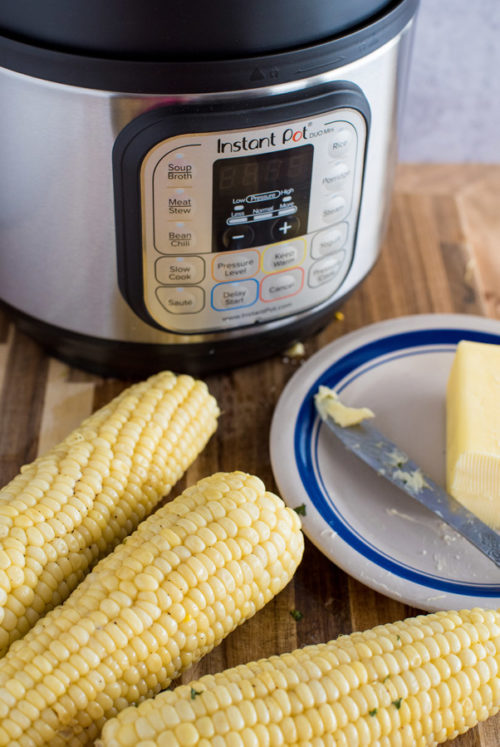 Corn on the Cob, soft butter, and an Instant Pot in the background